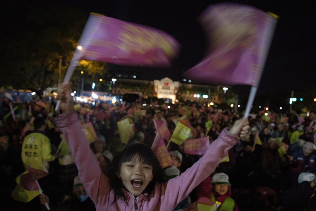In this Wednesday, Jan. 8, 2020, photo, supporters of Tsai Ing-wen, Taiwan's President and the 2020 presidential election candidate for the Democratic...