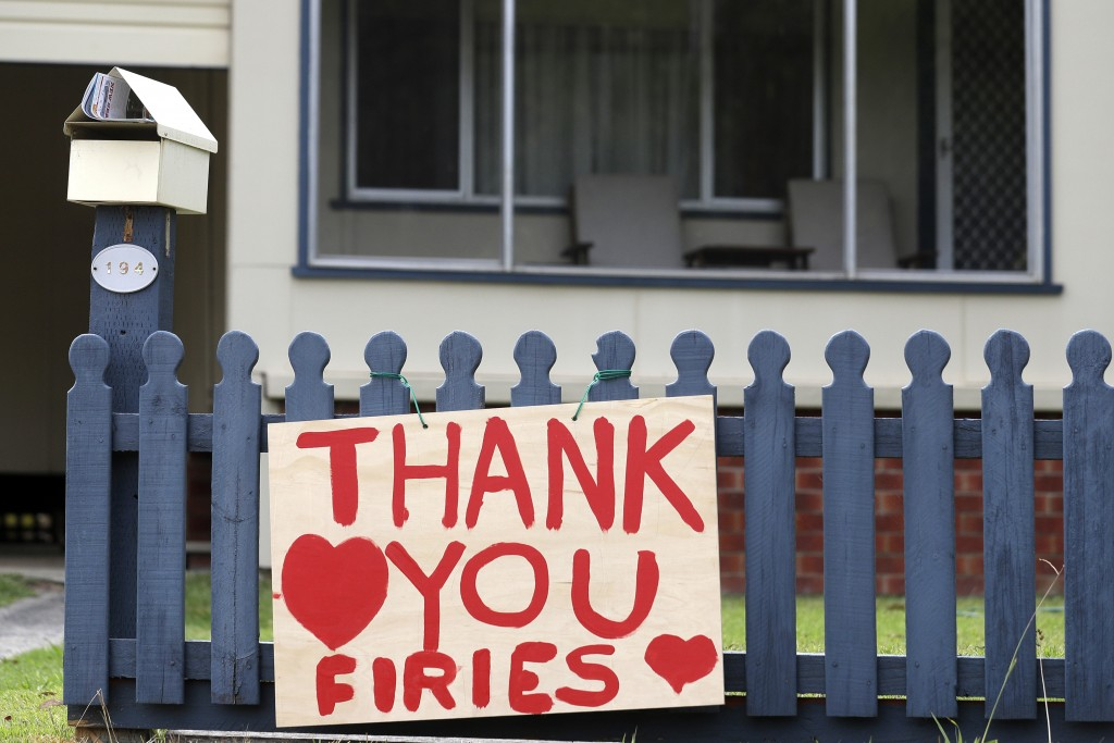 "A sign is displayed near Ulludulla, Australia, Thursday, Jan. 9, 2020, thanking ""firies"" a colloquial term for firefighters. House after house in affe..."