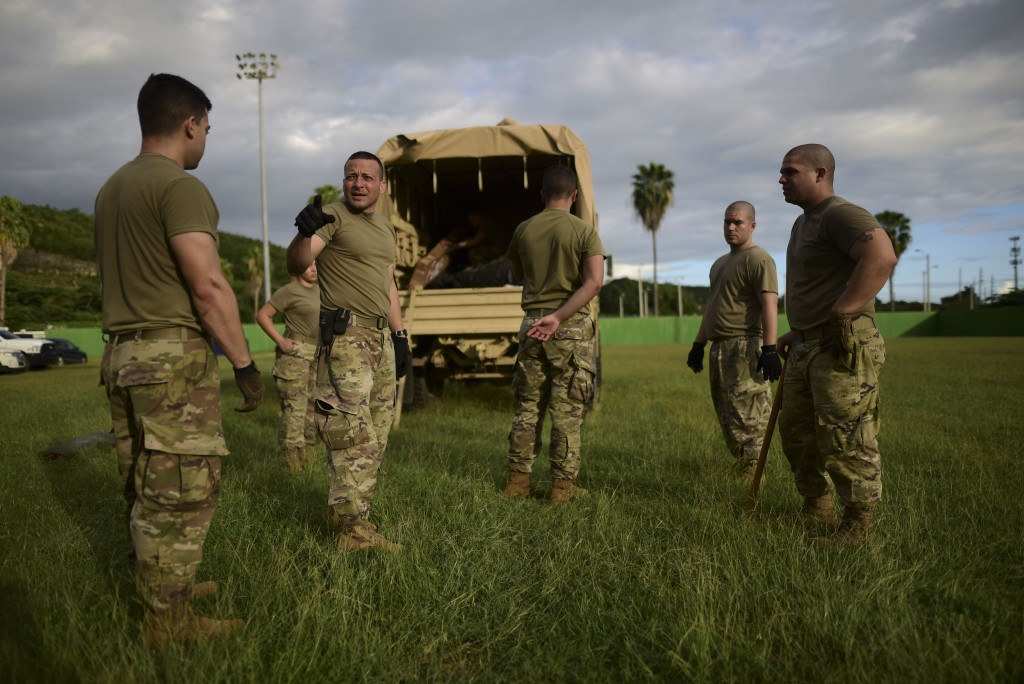 National Guardsmen begin to install a government shelter at the municipal stadium in Guayanilla, Puerto Rico, Wednesday, Jan. 8, 2020. More than 250,0...