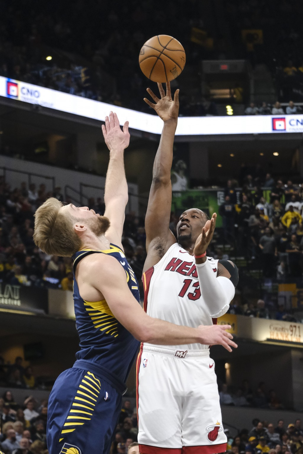 Miami Heat center Bam Adebayo (13) shoots over Indiana Pacers forward Domantas Sabonis (11) during the first half of an NBA basketball game in Indiana...