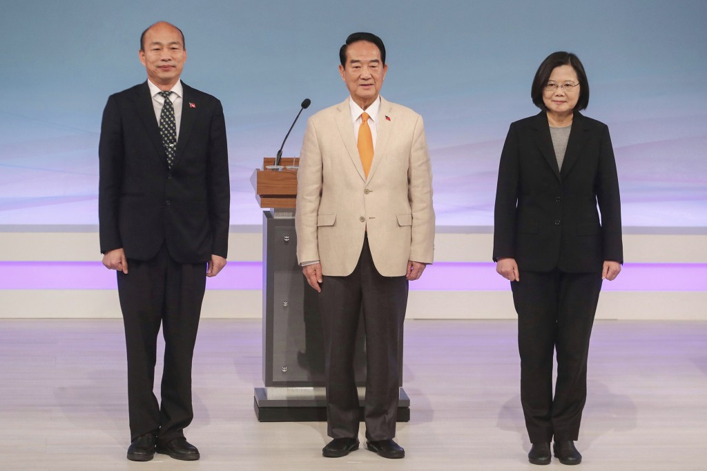 FILE - In this Dec. 29, 2019, file photo, Taiwan's 2020 presidential election candidates, from right, Democratic Progressive Party's Tsai Ing-wen, Peo...