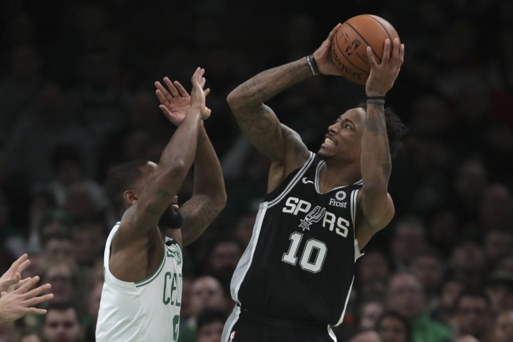 San Antonio Spurs guard DeMar DeRozan (10) shoots over Boston Celtics guard Brad Wanamaker, left, during the third quarter of an NBA basketball game W...