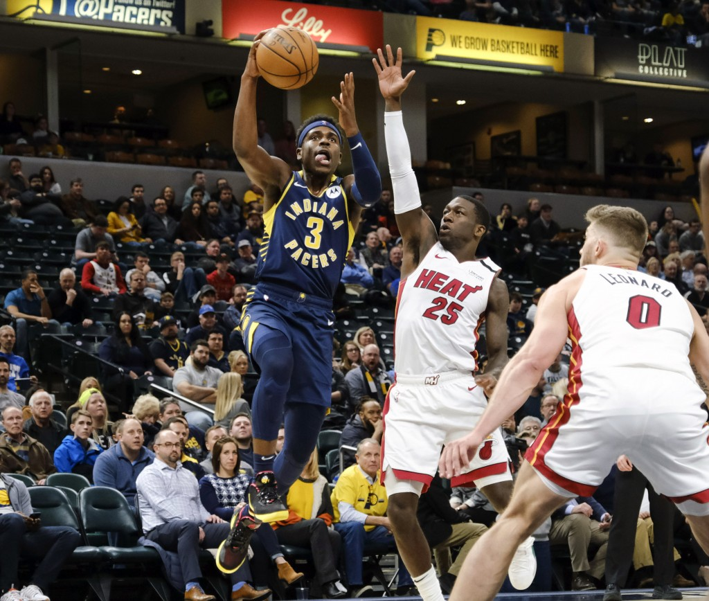 Indiana Pacers guard Aaron Holiday (3) shoots in front of Miami Heat guard Kendrick Nunn (25) during the second half of an NBA basketball game in Indi...