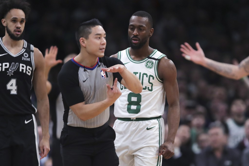 Boston Celtics guard Kemba Walker (8) watches as referee Evan Scott charges him with a technical foul during the third quarter of an NBA basketball ga...