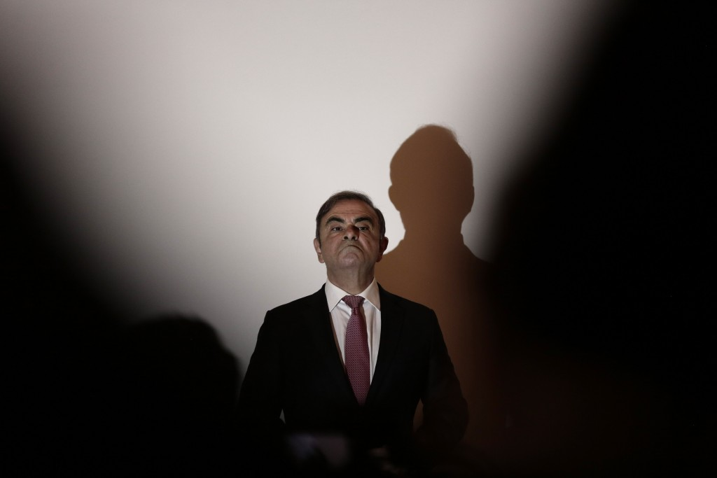 Nissan's former chairman Carlos Ghosn arrives for a press conference in Beirut, Lebanon, Wednesday, Jan. 8, 2020. (AP Photo/Maya Alleruzzo)