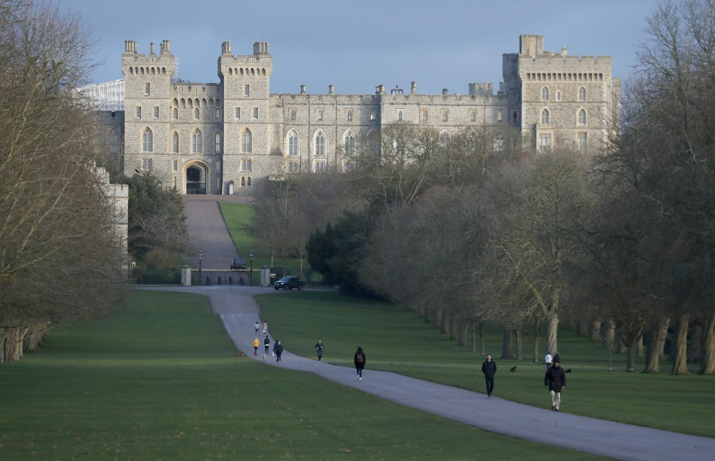 Pedestrians walk the Long Walk in front of Windsor Castle, near the Frogmore Cottage home of Britain's Prince Harry and Meghan Duchess of Sussex in Wi...
