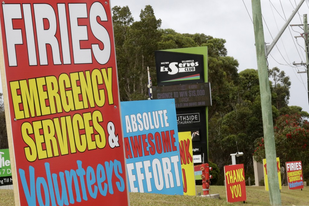 "Signs are displayed near Ulludulla, Australia, Thursday, Jan. 9, 2020, thanking ""firies"" a colloquial term for firefighters. House after house in affe..."