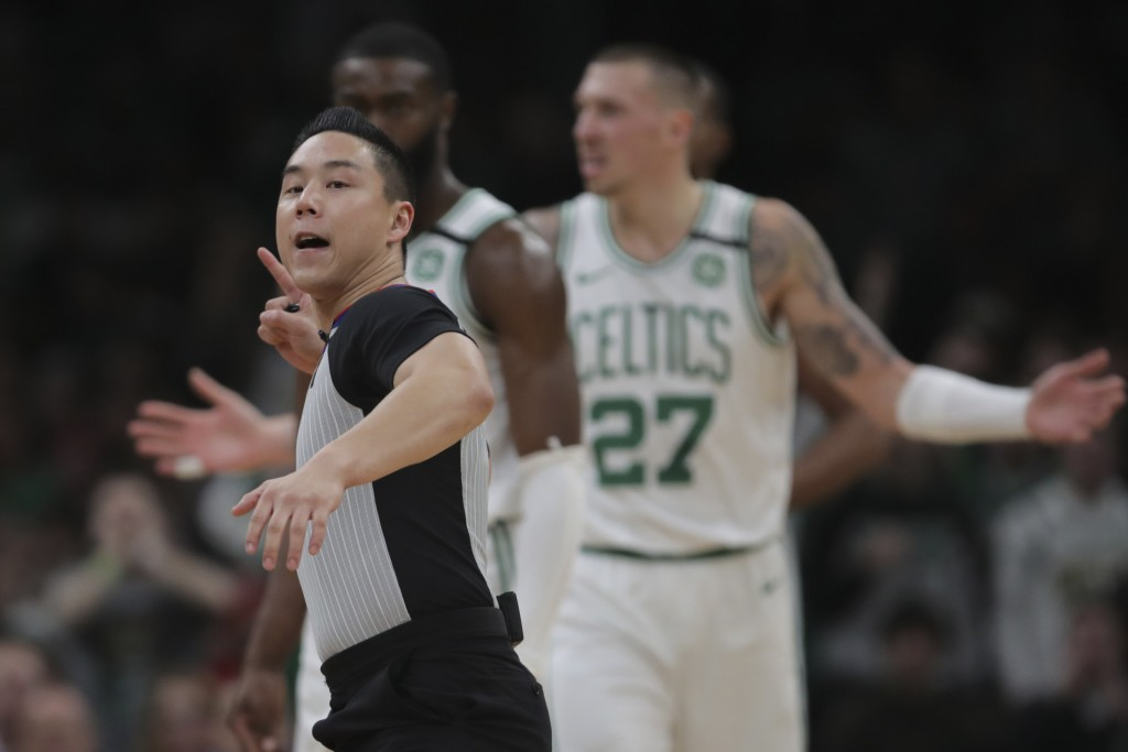 Referee Evan Scott ejects Boston Celtics guard Kemba Walker during the third quarter of an NBA basketball game against the San Antonio Spurs, Wednesda...