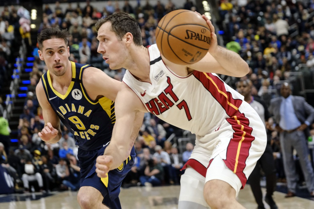 Miami Heat guard Goran Dragic (7) drives in front of Indiana Pacers guard T.J. McConnell (9) during the first half of an NBA basketball game in Indian...