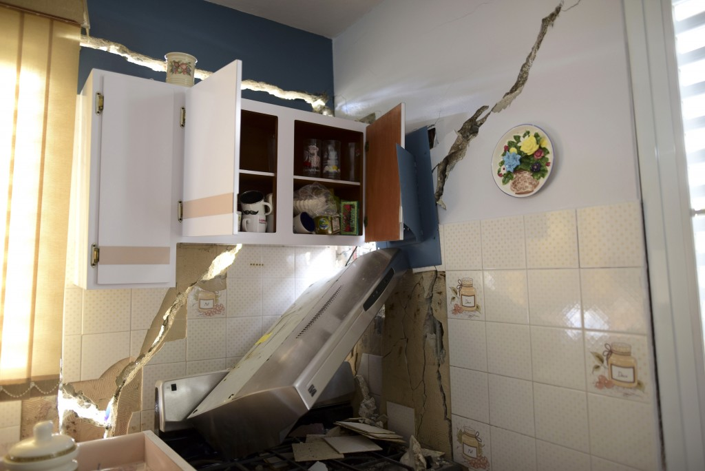 The house of William Mercuchi is damaged after the previous day's magnitude 6.4 earthquake in Yauco, Puerto Rico, Wednesday, Jan. 8, 2020. More than 2...