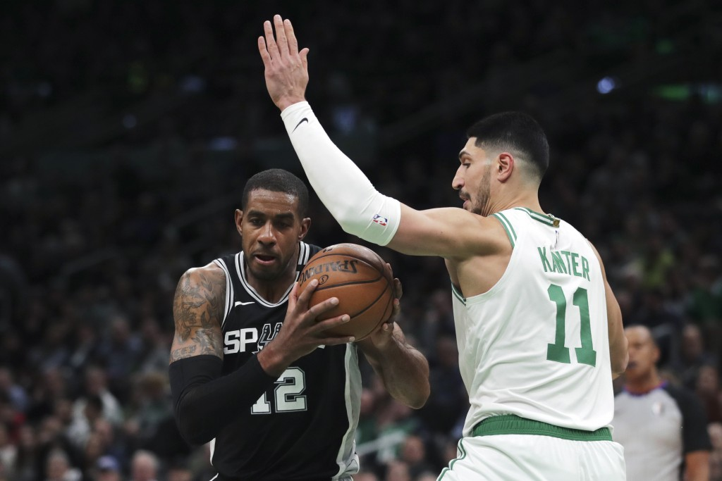 Boston Celtics center Enes Kanter (11) tries to block San Antonio Spurs center LaMarcus Aldridge (12) during the first half of an NBA basketball game ...