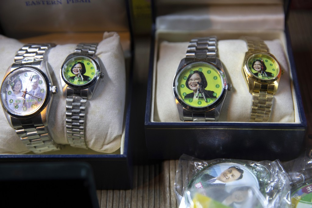 In this Wednesday, Jan. 8, 2020, photo, wrist watches with a picture of Tsai Ing-wen, Taiwan's President and the 2020 presidential election candidate ...