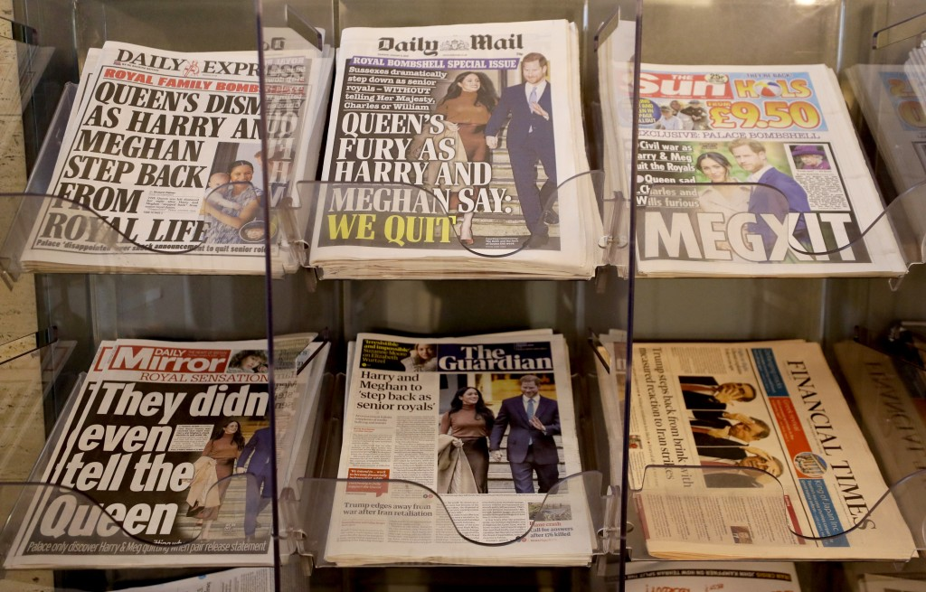 """Newspapers are seen for sale in London, Thursday, Jan. 9, 2020. In a statement Prince Harry and his wife, Meghan, said they are planning """"to step back..."""