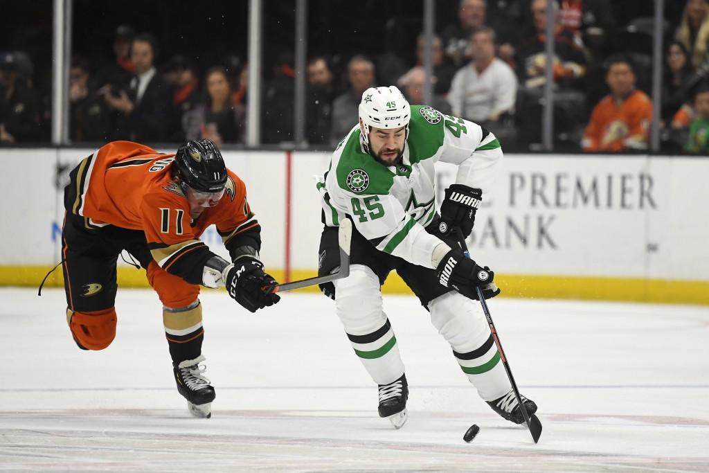Anaheim Ducks right wing Daniel Sprong, left, reaches for Dallas Stars defenseman Roman Polak as Polak takes the puck during the first period of an NH...