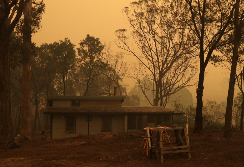 A mud brick house owned by Evan Harris where he is preparing to minimize fire impact at Burragate, Australia, Friday, Jan. 10, 2020, as a nearby fire ...