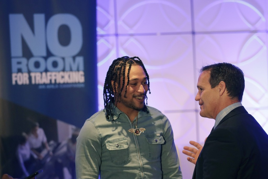 Miami Dolphins wide receiver Albert Wilson, left, speaks with Ray Martinez, executive director of the Miami Super Bowl Host Committee, during a meetin...