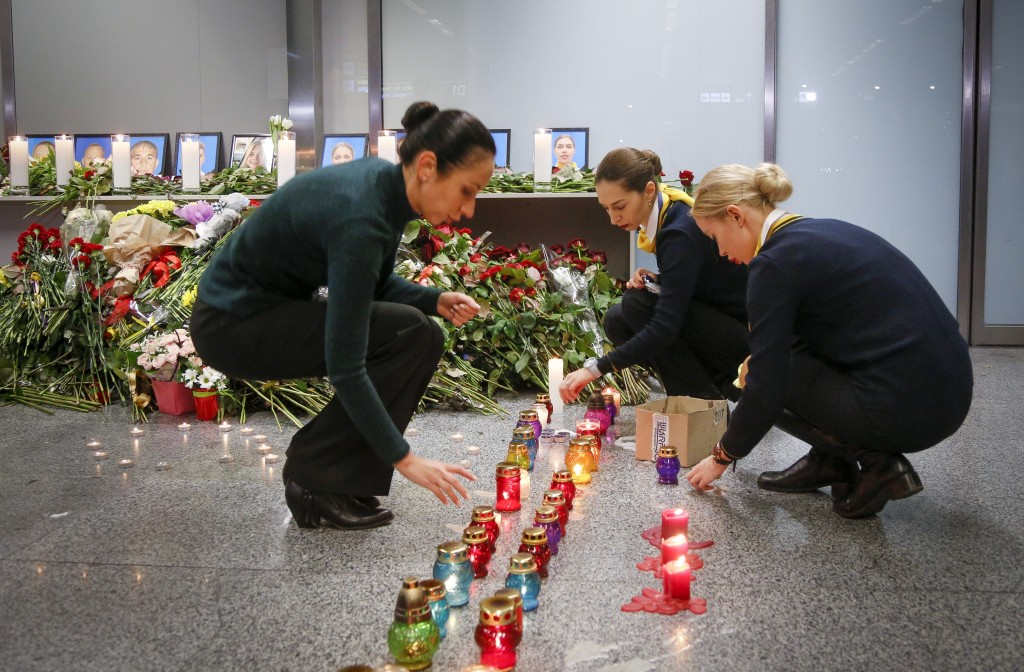 FILE - In this Wednesday, Jan. 8, 2020 file photo, colleagues of the flight crew members of the Ukrainian 737-800 plane that crashed on the outskirts ...
