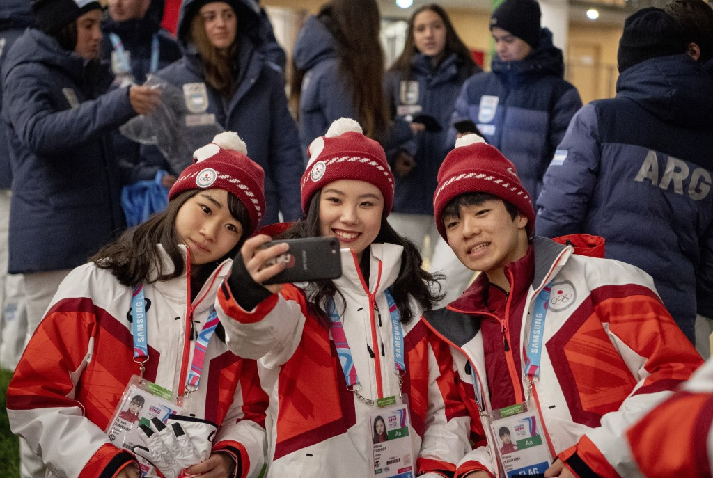 In this photo provided by the IOC, Japanese athletes pose for a selfie at the Vortex in the Youth Olympic Village, Thursday, Jan. 9, 2020, at the 2020...