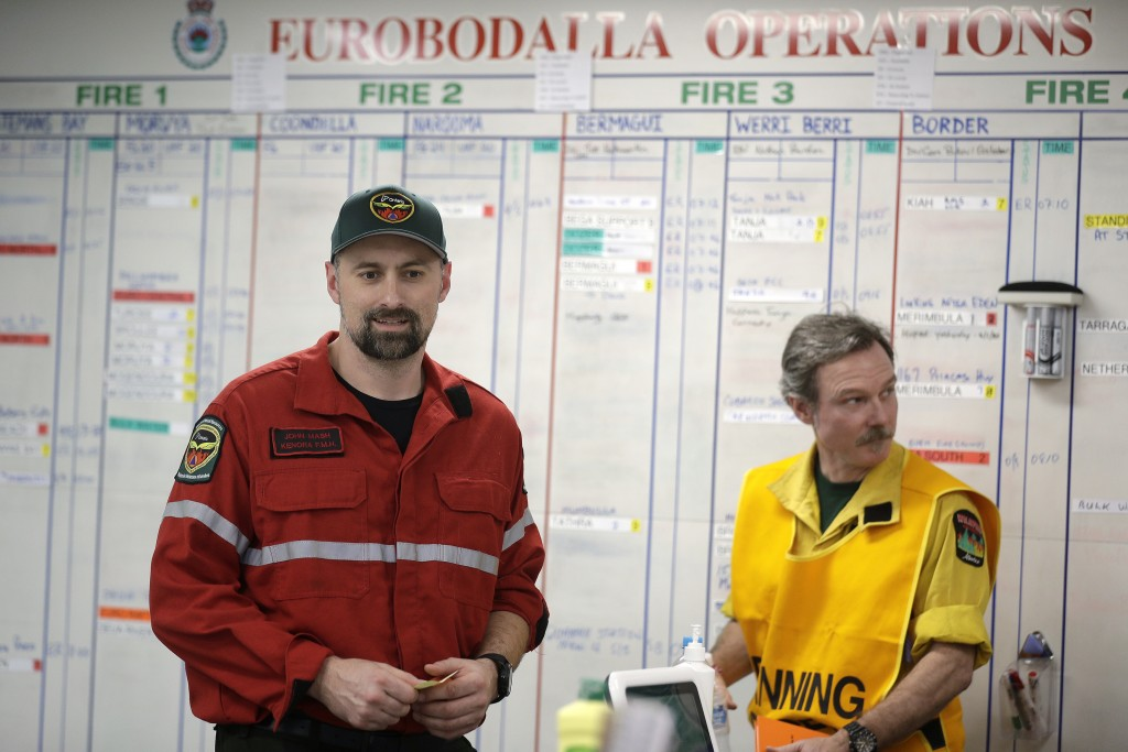 In this Thursday, Jan. 9, 2020, photo, John Mash, left, a fire operations supervisor for the Ministry of Natural Resources in Ontario, Canada, works i...