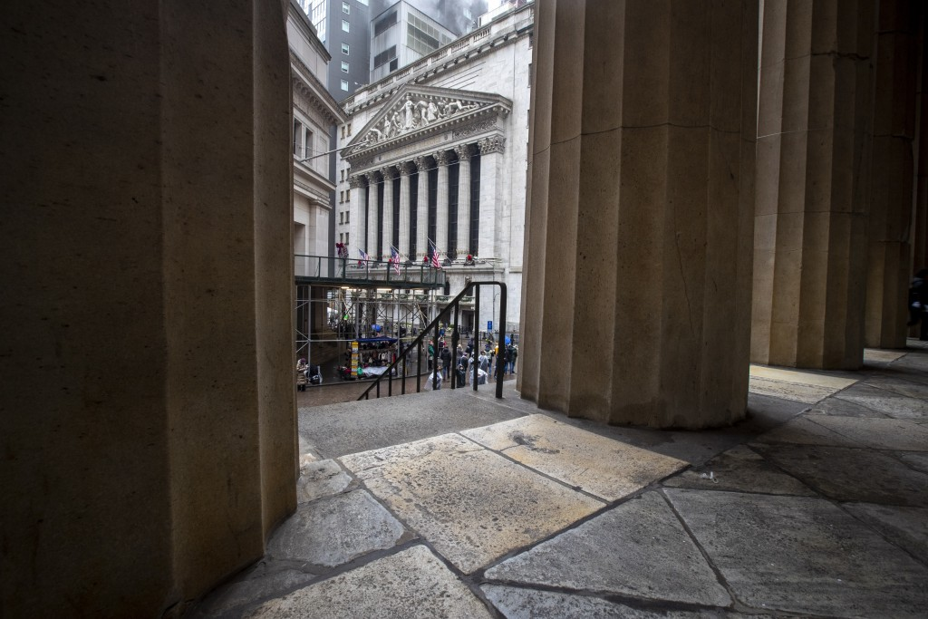 FILE - In this Jan. 3, 2020, file photo the New York Stock Exchange is framed by the columns at Federal Hall National Memorial in New York. The U.S. s...