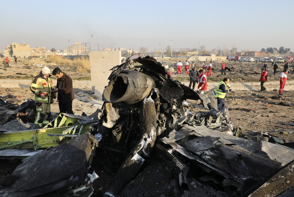 FILE - In this Wednesday, Jan. 8, 2020 file photo, debris at the scene where a Ukrainian plane crashed in Shahedshahr southwest of the capital Tehran,...