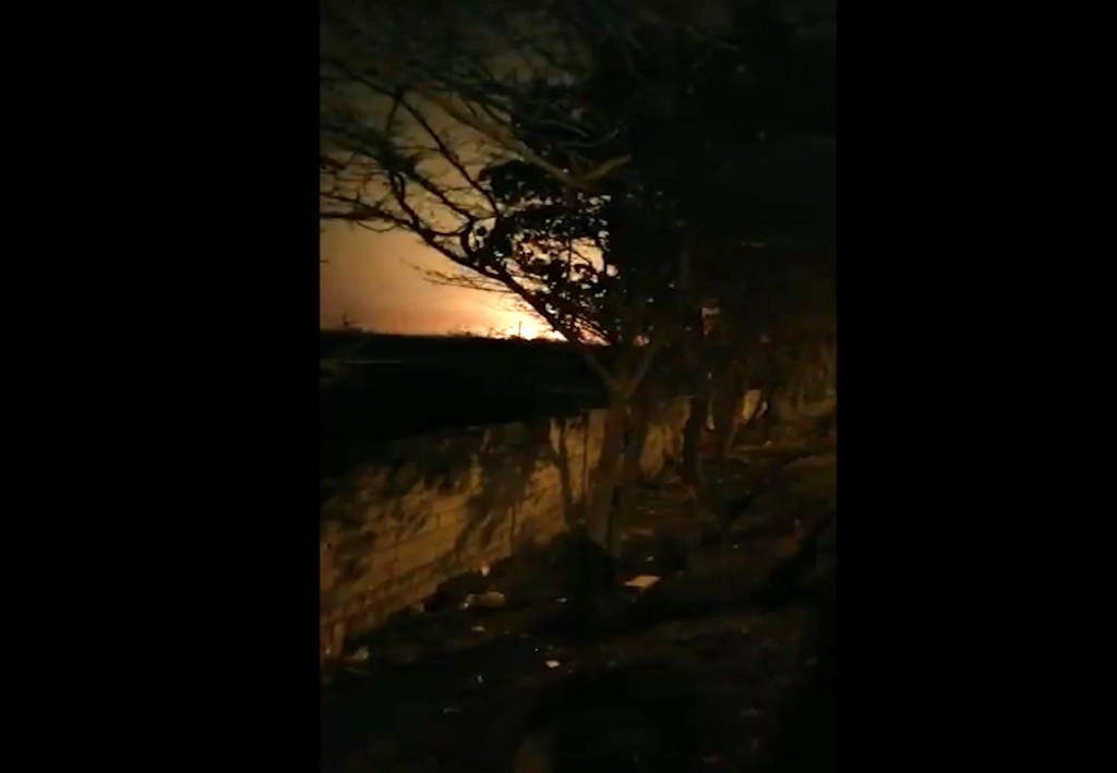 This image taken from a video on Wednesday Jan. 8, 2020 shows a light in the sky which appears to show the Ukrainian jetliner plane on fire and crashi...