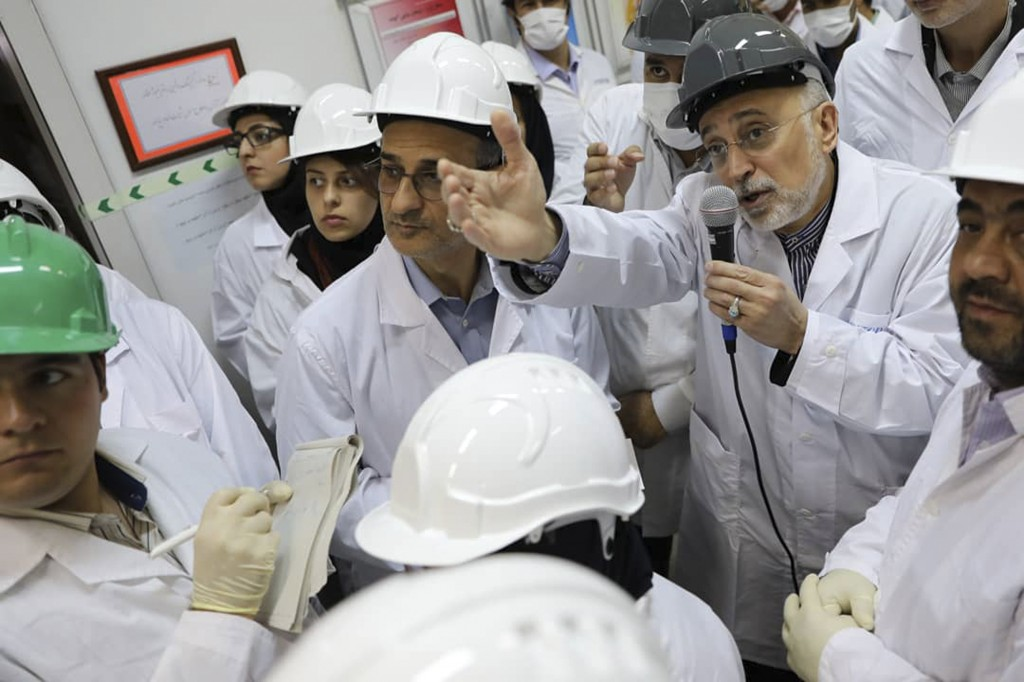 FILE - In this file photo released Nov. 4, 2019 by the Atomic Energy Organization of Iran, Ali Akbar Salehi, head of the organization, speaks with med...