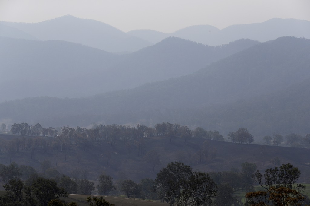Smoke hangs in layers in the mountains near Bemboka Friday, Jan. 10, 2020. Thousands of people are fleeing their homes and helicopters are dropping su...