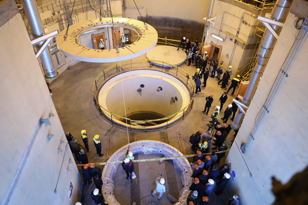 FILE - In this Dec. 23, 2019 file photo released by the Atomic Energy Organization of Iran, technicians work at the Arak heavy water reactor's seconda...