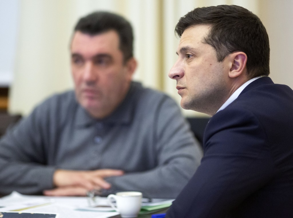 In this handout photo provided by the Ukrainian Presidential Press Office, Ukrainian President Volodymyr Zelenskiy leads a meeting of the emergency re...