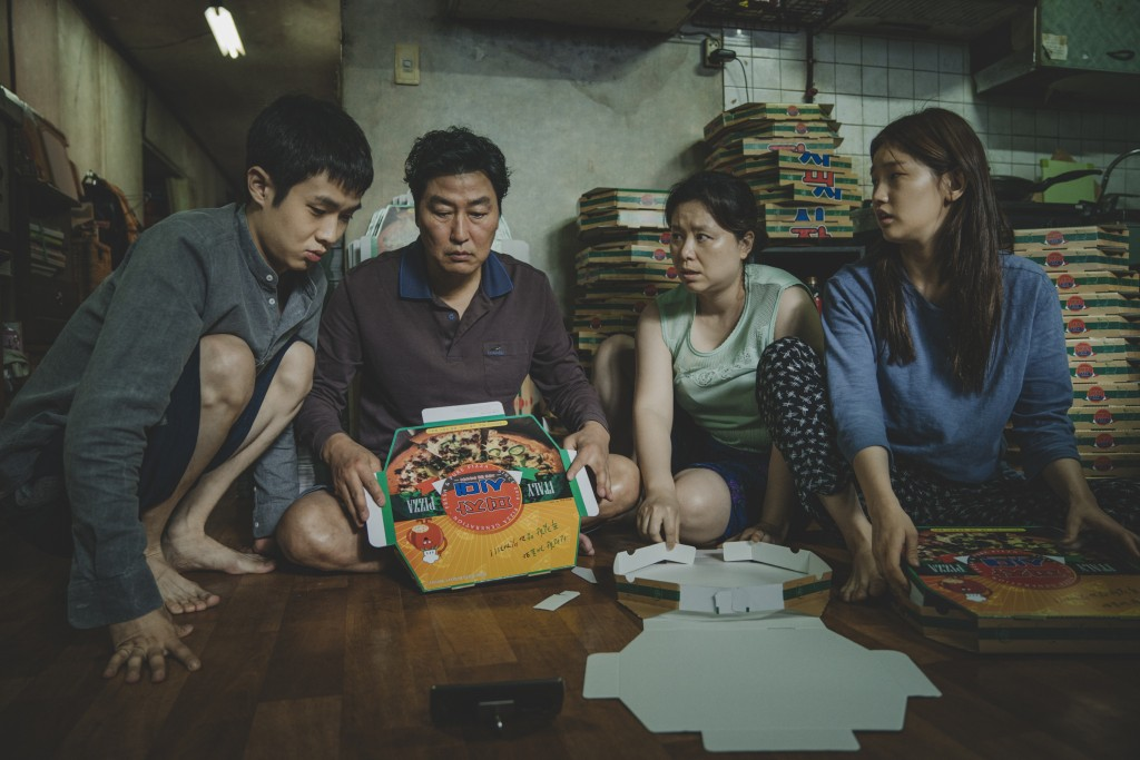 "This image released by Neon shows Woo-sik Choi, from left, Kang-ho Song, Hye-jin Jang and So-dam Park in a scene from ""Parasite."" Nominations to the 9..."