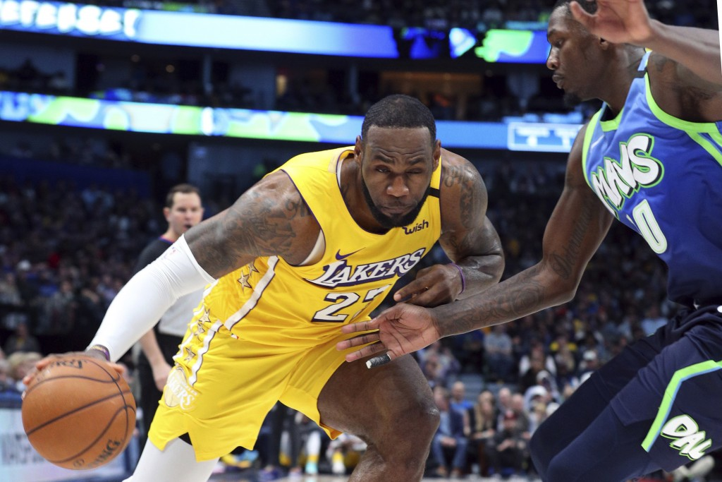 Los Angeles Lakers forward LeBron James (23) tries to drive past Dallas Mavericks forward Dorian Finney-Smith (10) during the second half of an NBA ba...