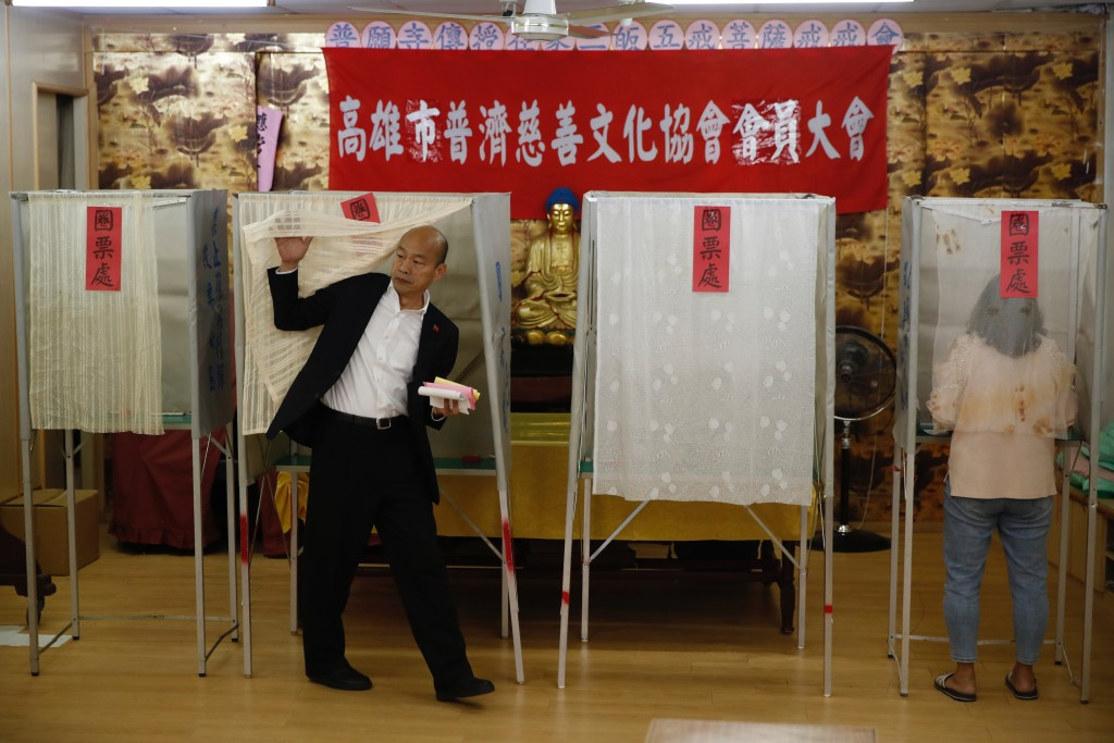Han Kuo-yu, Taiwan's 2020 presidential election candidate of the KMT or Nationalist Party, waits to cast his votes at a polling station in southern Ta...
