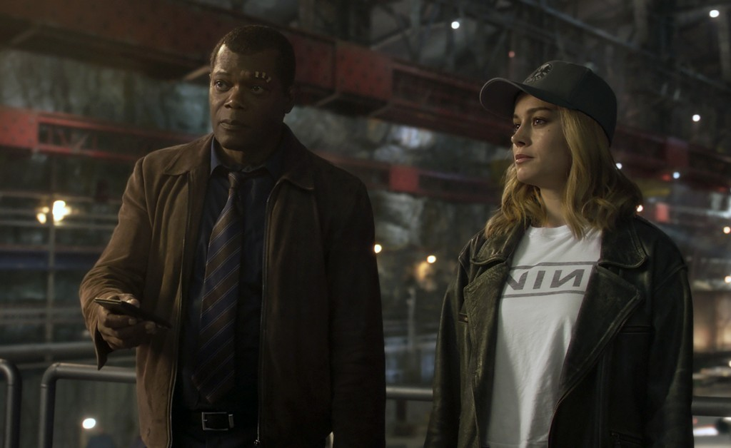 """This image released by Disney-Marvel shows Samuel L. Jackson as a younger Nick Fury, left, and Brie Larson in a scene from """"Captain Marvel. New digita..."""