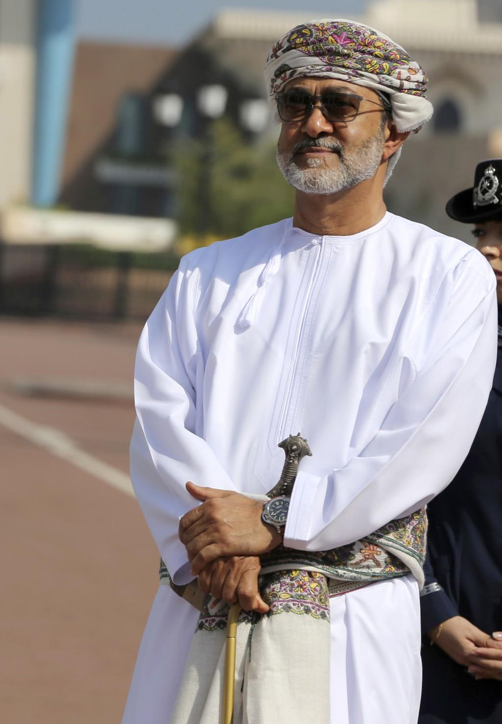 In this Nov. 5, 2016, photo, Oman's new sultan, Haitham bin Tariq Al Said, is seen while welcoming Britain's Prince Charles and his wife, Camilla, Duc...