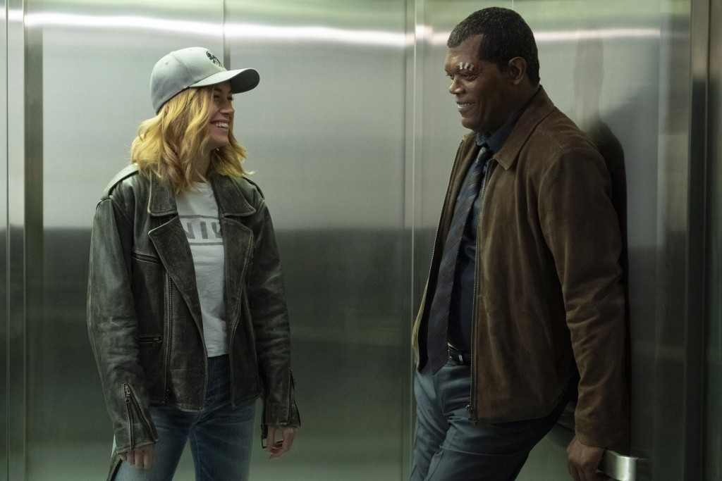 """This image released by Disney-Marvel shows Samuel L. Jackson, right, with Brie Larson on the set of """"Captain Marvel."""" New digital de-aging techniques ..."""