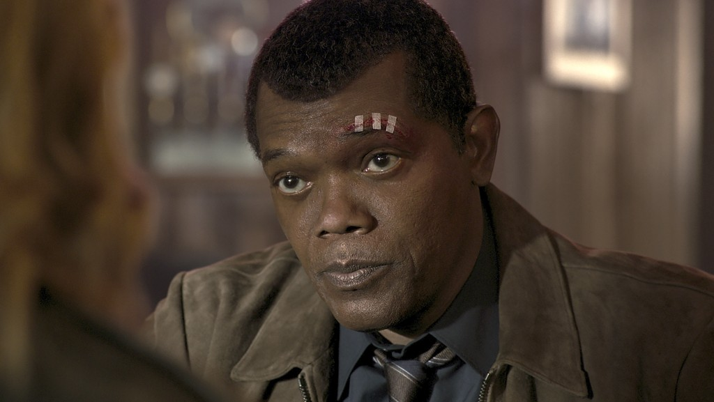 """This image released by Disney-Marvel shows Samuel L. Jackson as a younger Nick Fury in a scene from """"Captain Marvel. New digital de-aging techniques h..."""