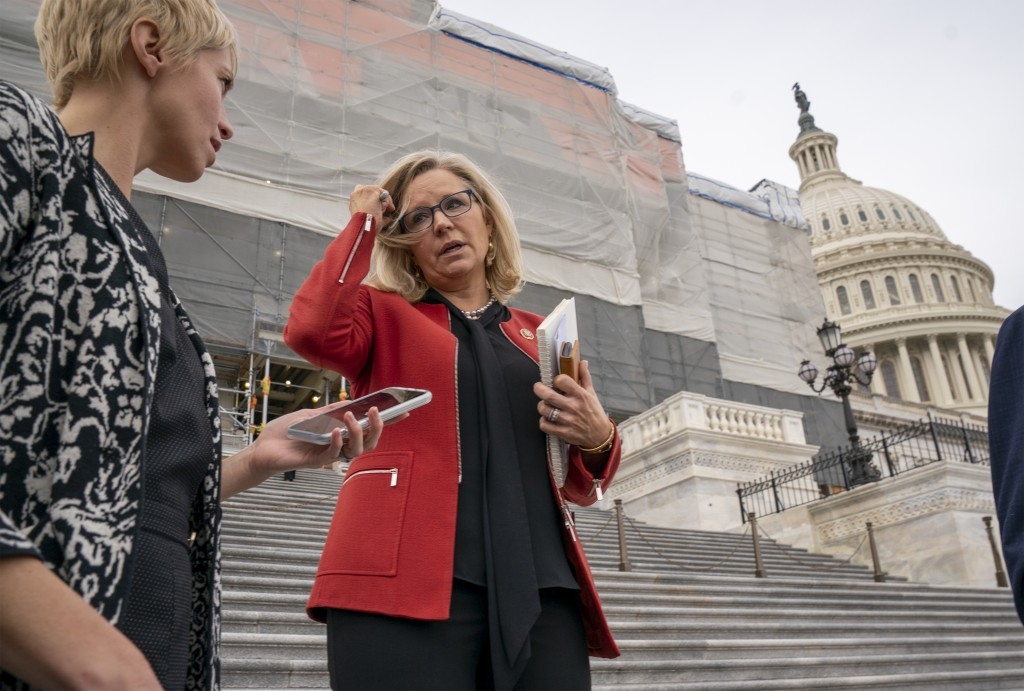 Republican Conference chair Rep. Liz Cheney, R-Wyo., speaks with reporters as lawmakers leave the Capitol in Washington, Friday, Jan. 10, 2020. House ...