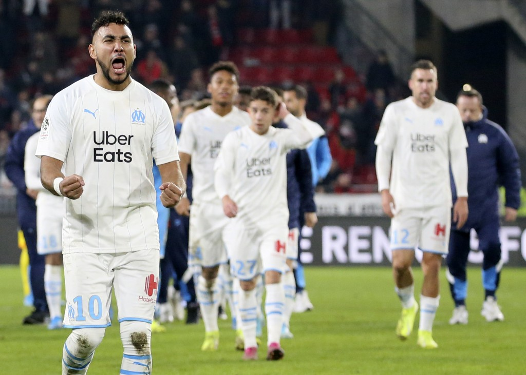Marseille's Dimitri Payet, left, celebrates at the end of the League One soccer match between Rennes and Marseille, at the Roazhon Park stadium in Ren...