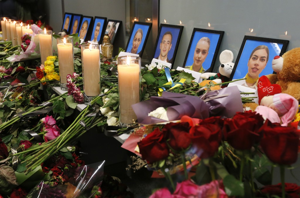 Flowers and candles are placed in front of portraits of the flight crew members of the Ukrainian 737-800 plane that crashed on the outskirts of Tehran...