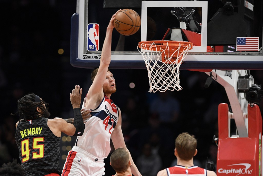 Washington Wizards forward Davis Bertans (42) goes to the basket past Atlanta Hawks guard DeAndre' Bembry (95) during the first half of an NBA basketb...