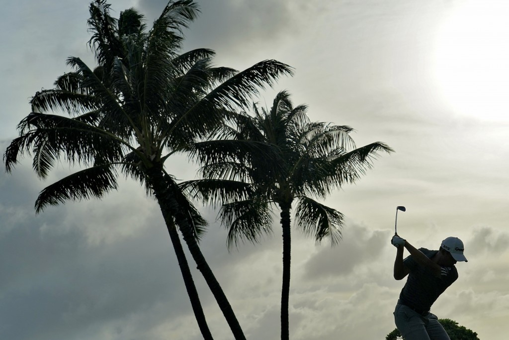 Collin Morikawa hits from the 17th tee during the second round of the Sony Open PGA Tour golf event, Friday, Jan. 10, 2020, at Waialae Country Club in...