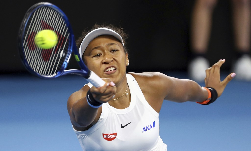 Naomi Osaka of Japan makes a forehand return during her semifinal match against Karolina Pliskova of the Czech Republic at the Brisbane International ...