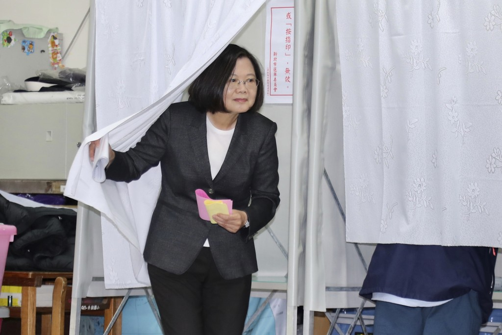 Taiwanese President and presidential election candidate Tsai Ing-wen emerges from a voting booth at a polling station in New Taipei City, Taiwan, Satu...