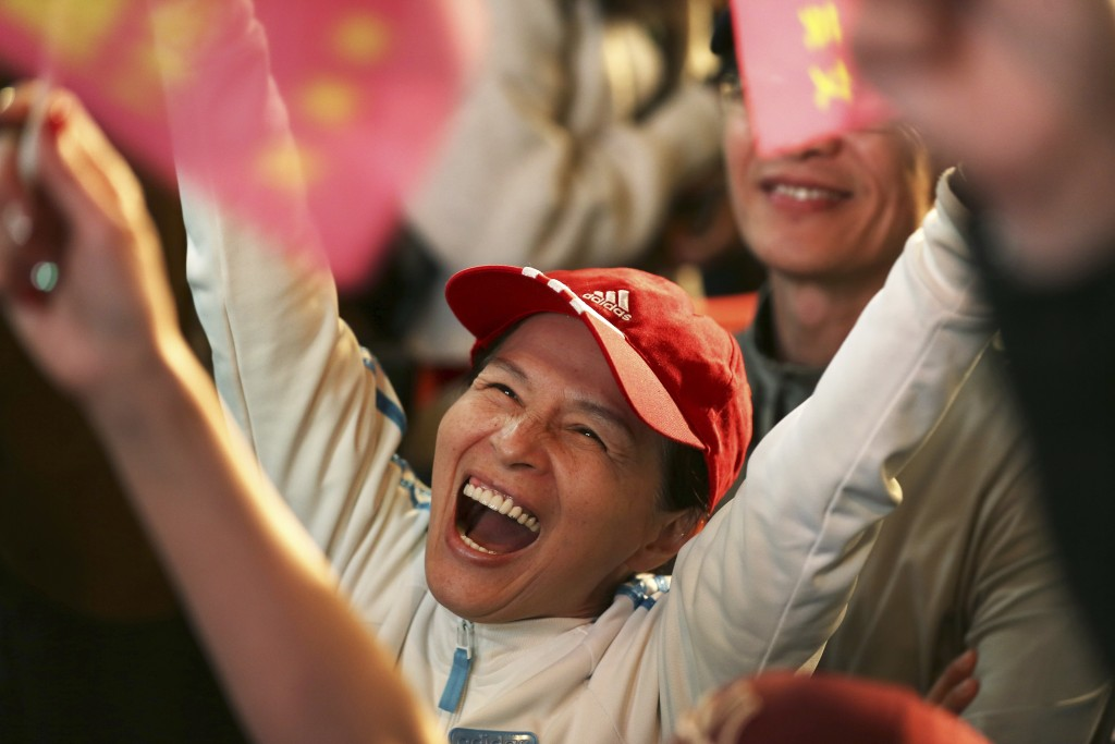 A supporter of Taiwan's 2020 presidential election candidate, Taiwan president Tsai Ing-wen cheers for Tsai's victory in Taipei, Taiwan, Saturday, Jan...