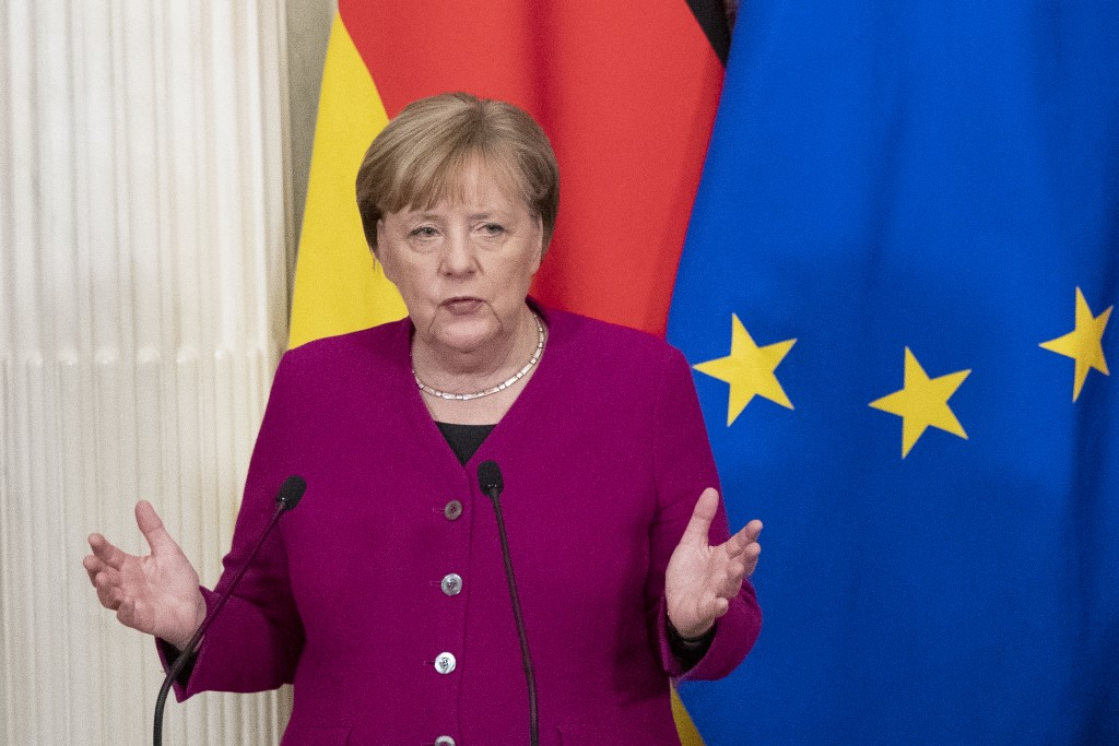 German Chancellor Angela Merkel gestures during her and Russian President Vladimir Putin joint news conference following their talks in the Kremlin in...