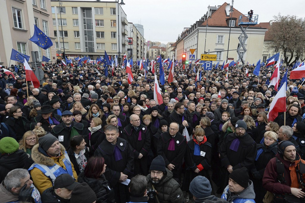 Judges and lawyers from across Europe, many of them dressed in their judicial robes, march silently in Warsaw, Poland, Saturday, Jan. 11, 2020. The ra...