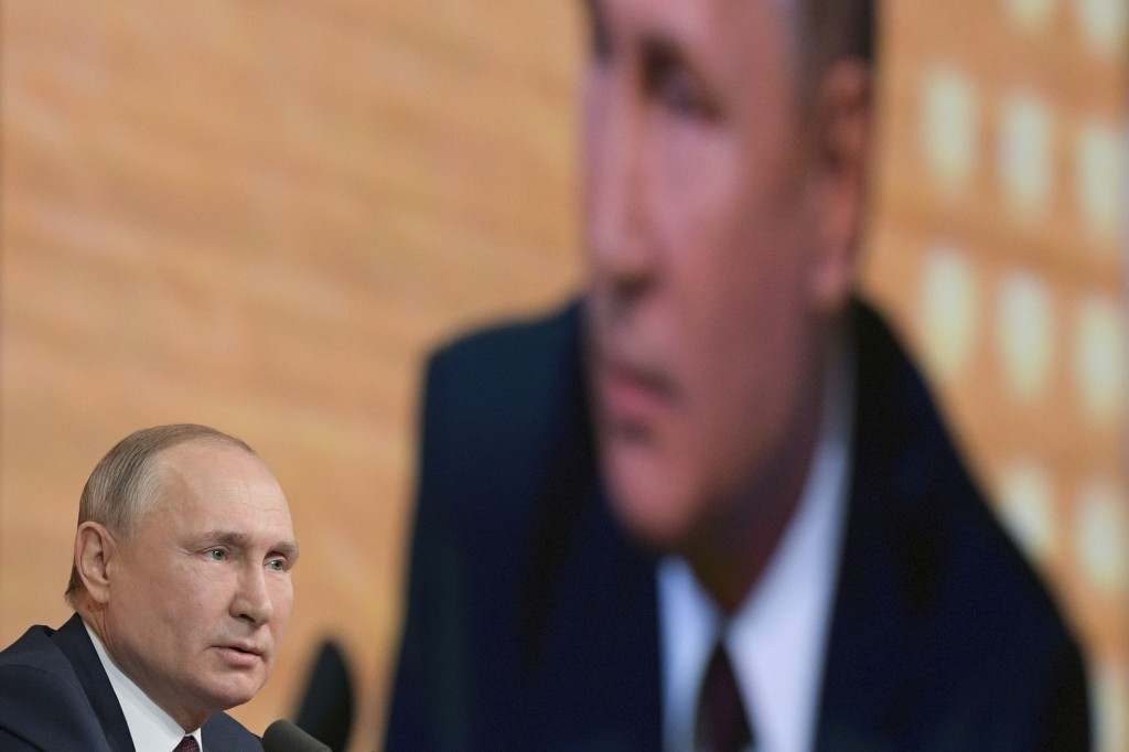FILE - In this Thursday, Dec. 19, 2019 file photo, President Vladimir Putin speaks during his annual news conference in Moscow, Russia. An Associated ...
