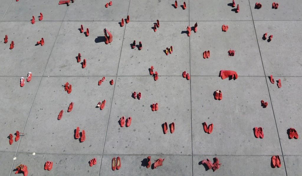 Women's red shoes are spread out in the Zocalo where they were placed by activists to protest violence against women in Mexico City, Saturday, Jan. 11...