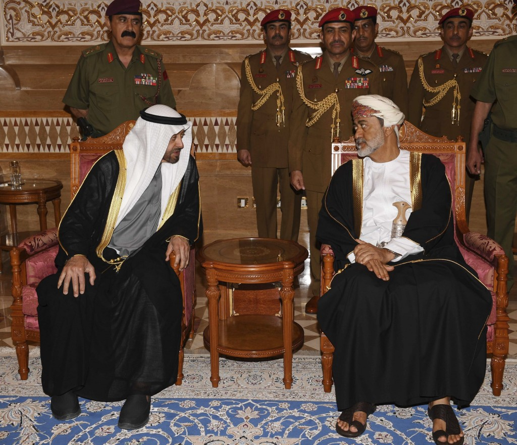 In this photo made available by Oman News Agency, Oman's new Sultan Haitham bin Tariq Al Said, right, receives Sheikh Mohammed bin Zayed Al Nahyan, th...